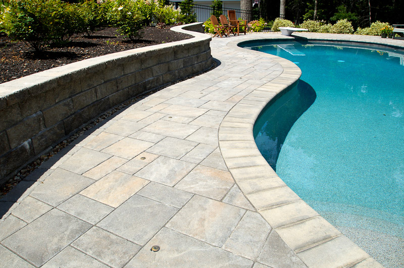 Pool coping installation to compliment your hardscape - Installing pavers around swimming pool ...